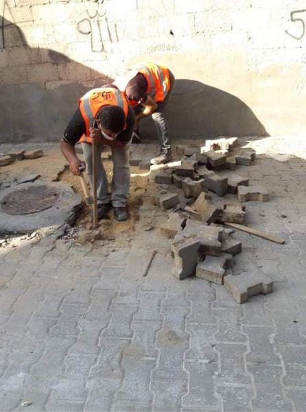 جانب من أعمال الصيانة بشارع البيئة